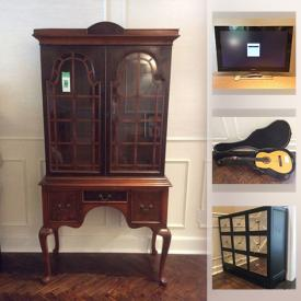 MaxSold Auction: This online auction features glass coffee table, area rug, antique Burled walnut furniture, original art, costume jewelry, mirrored cabinet, Rosenthal China set, polaroid TV, patio furniture, guitar and much more!