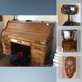 """MaxSold Auction: This online auction features furniture such as faux leather sofa, end tables, bookcases, armoire cabinet, antique desk, antique mirror, and antique dresser, Meade telescope, 50"""" Samsung TV, lamps, linens, home decor, office supplies, art such as stained glass, framed prints, and African artwork, books, area rugs, trunks, small kitchen appliances, glassware, serve ware, garden furniture, luggage, Christmas decor, washer and dryer and much more!"""