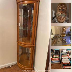 MaxSold Auction: This online auction features furniture, glass display cases, clocks, watches, turntable, records, glassware, ceramics, shelving units, Trading cards and much more.
