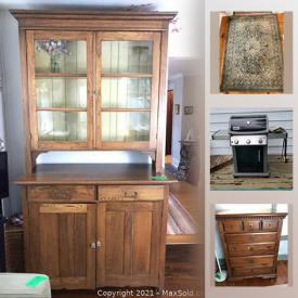 MaxSold Auction: This online auction features furniture such as antique wooden table, microsuede sofa, and antique hutch, area rugs, dishware, glassware, gardening tools, leather bags, books, lamps, planters, workbench and much more!