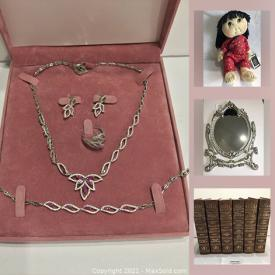 MaxSold Auction: This online auction features collectible Rice Paddy dolls, metal bar signs, vacuum, Car jack, vintage books, jewelry, Ammolite rings and much more!