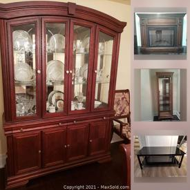 MaxSold Auction: This online auction features a China hutch, Dining Table, Curio cabinet, Entertainment console shelf unit, Electric fireplace, TV stand and Coffee table and much more