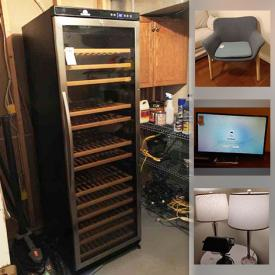"""MaxSold Auction: This online auction features furniture such as cabinets, entertainment center, sleeper sofa, and wooden dresser, 54"""" Samsung TV, Blu-Ray player, lamps, holiday decor, books, wall art, small kitchen appliances, area rugs, dishware, glassware, Weber grill, wine cooler, shelving, garden tools and much more!"""