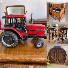 """MaxSold Auction: This online auction features antique organ, model trains, fine china, sterling silver, collectibles such as John Deere, vintage dolls, diecast cars, and vintage lanterns, furniture such as antique dressers, recliners, media cabinets, roll top desk, and dining room table, CDs, DVDs, power tools, chest freezer, stemware, glassware, 40"""" Toshiba TV, office supplies and much more!"""