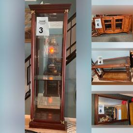 MaxSold Auction: This online auction features mirrors, console table, tall cabinet with a glass door, wood TV cabinet, curtains and much more!