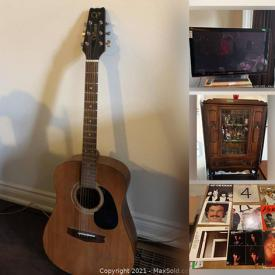 """MaxSold Auction: This online auction includes 50"""" Samsung TV, furniture such as sideboard, wooden chairs, stereo cabinet, faux leather couch, and wooden dresser, suitcases, small kitchen appliances, Pioneer receiver, glassware, acoustic guitar, PlayStation 3, wall art, vinyl records, and more!"""