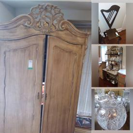 MaxSold Auction: This online auction features furniture such as chairs, end tables, king bed frame, antique armoire, chair sculptures, sofa, baker's rack and more, glassware, dishware, Baccarat decanter, Waterford crystal, serving dishes, coats, china, sconces, mirrors, lamps, lithographs and much more!