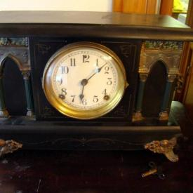 MaxSold Auction: Interesting offering including unusual 1800s Victorian round lamp table with hoofed feet, early 20th century wood fired State Crawford cookstove, a 1939 World's Fair postcard, mantle clock, cider press, and many other interesting articles!