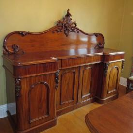 MaxSold Auction: Features Leather bound Charles Dickens series books, chandelier, Mahogany crank dining suite, art including oil on board, early desk with upper glass book case, stained glass hanging light fixture and much more!