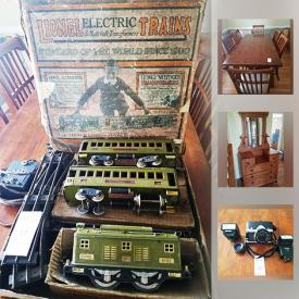MaxSold Auction: This online auction features dressers, head boards, ladder, model train, cameras, table saw, television, sports memorabilia, car carrier, and much more!